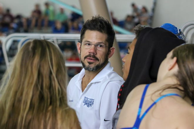 Washington High head coach Whitney Voeltz chats with some of his team during the FHSAA Class 3A District 1 championships at the University of West Florida on Friday, October 26, 2018.