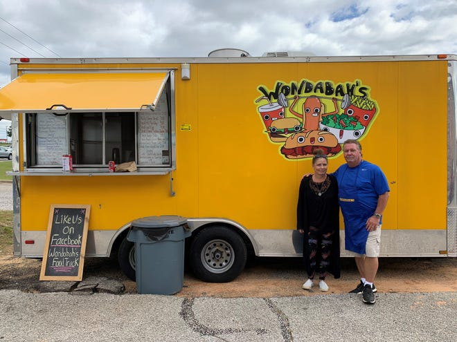 Wendie Anderson and Steve Kosh pose in front of their Wondabah's food truck on Bayou Boulevard. Wondabah's is a new food truck concept in Pensacola offering fresh sub sandwiches.