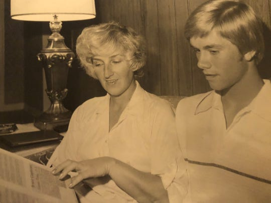 JIm Presley looks at newspaper clippings at home with his mohter, Lucinda, in 1979.