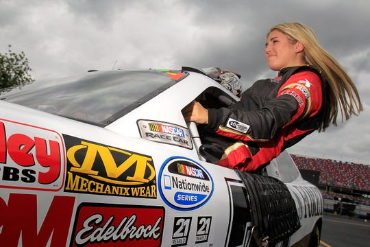 TALLADEGA, AL - MAY 03:  Johanna Long, driver of the #70 ForeTravel Chevrolet, climbs out of her car during qualifying of the NASCAR Nationwide Series Aaron's 312 at Talladega Superspeedway on May 3, 2013 in Talladega, Alabama.  (Photo by Sean Gardner/Getty Images)