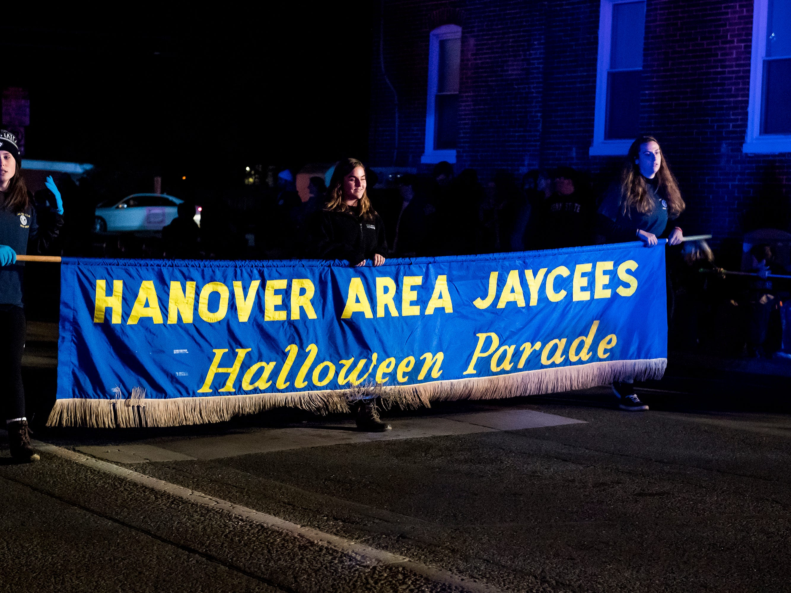 The Hanover Area Jaycees make their way onto Baltimore Street during the start of the 77th annual Hanover Halloween parade on Thursday, October 25, 2018.