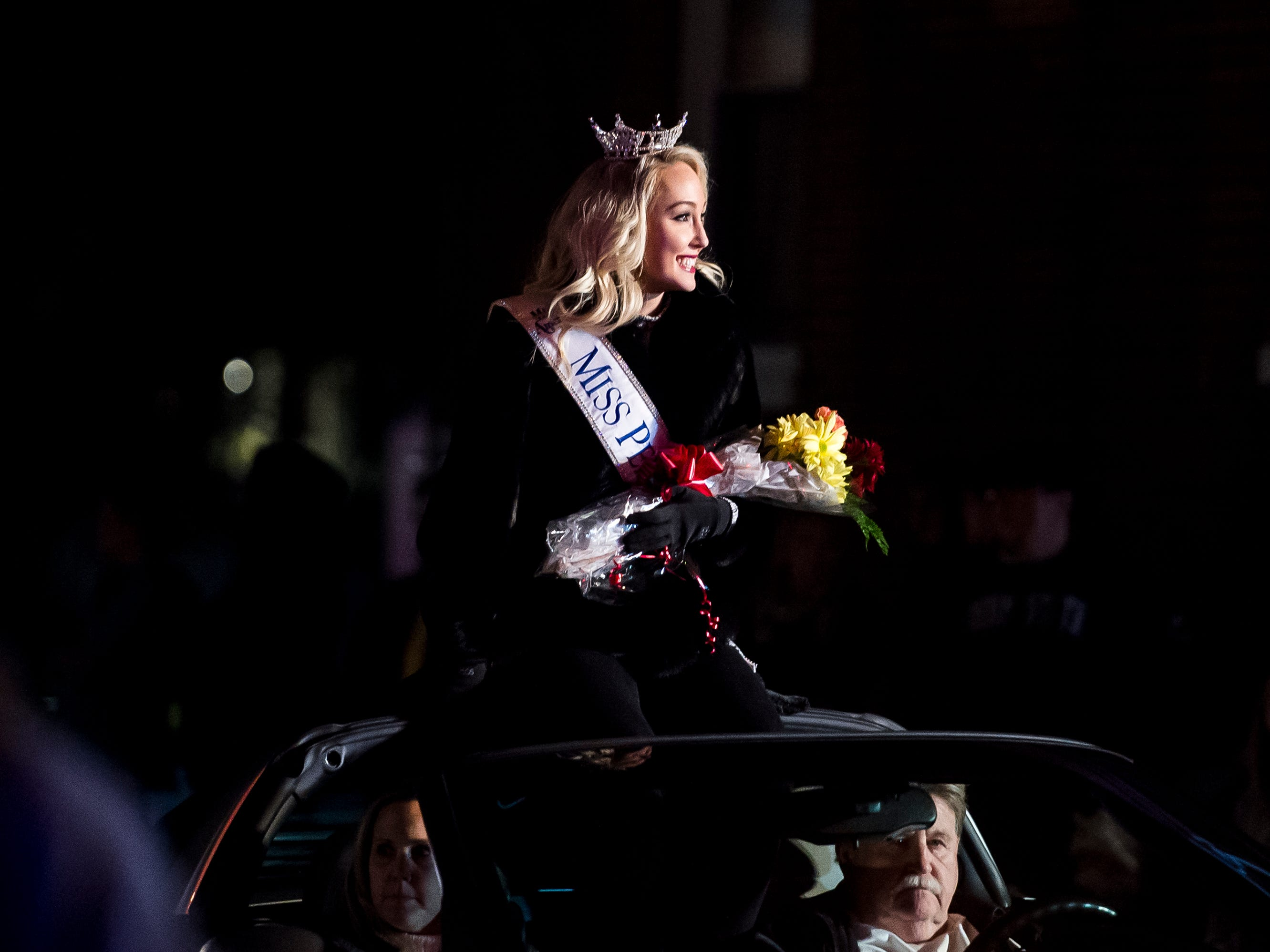 Miss Pennsylvania, Kayla Repasky, sits in the back of a vehicle during the 77th annual Hanover Halloween parade on Thursday, October 25, 2018.