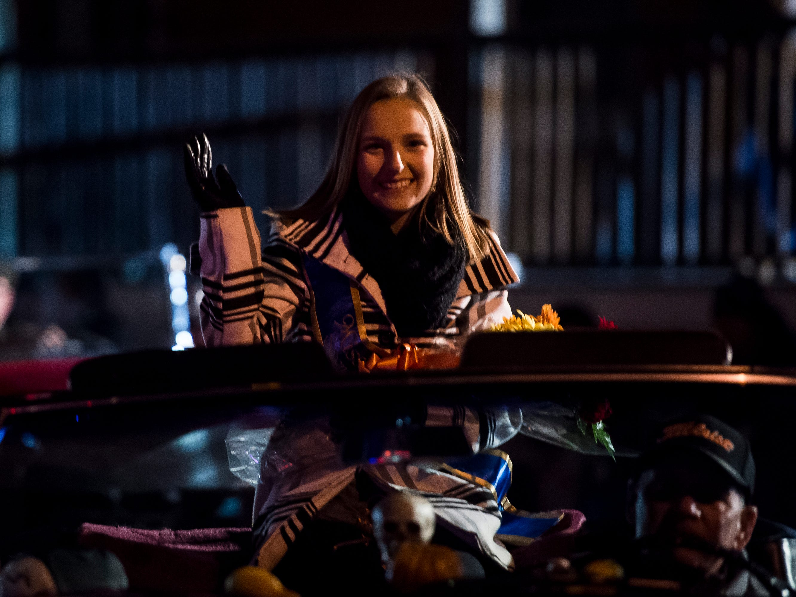 Miss Hanover Area second runner-up, Lindsay Boritz, rides in a car down Baltimore Street during the 77th annual Hanover Halloween parade on Thursday, October 25, 2018.