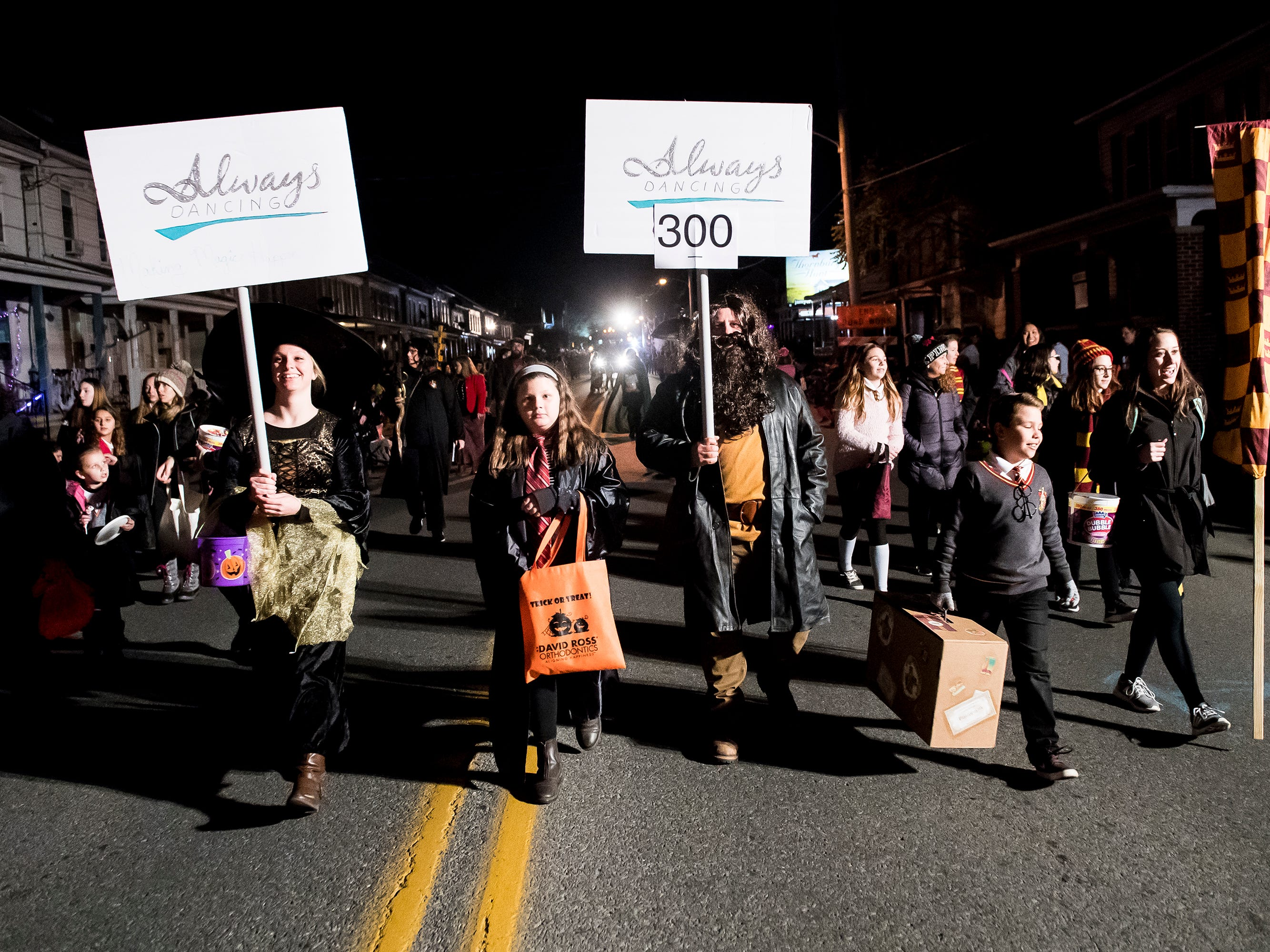 Members of Alway Dancing walk down Baltimore Street during the 77th annual Hanover Halloween parade on Thursday, October 25, 2018.
