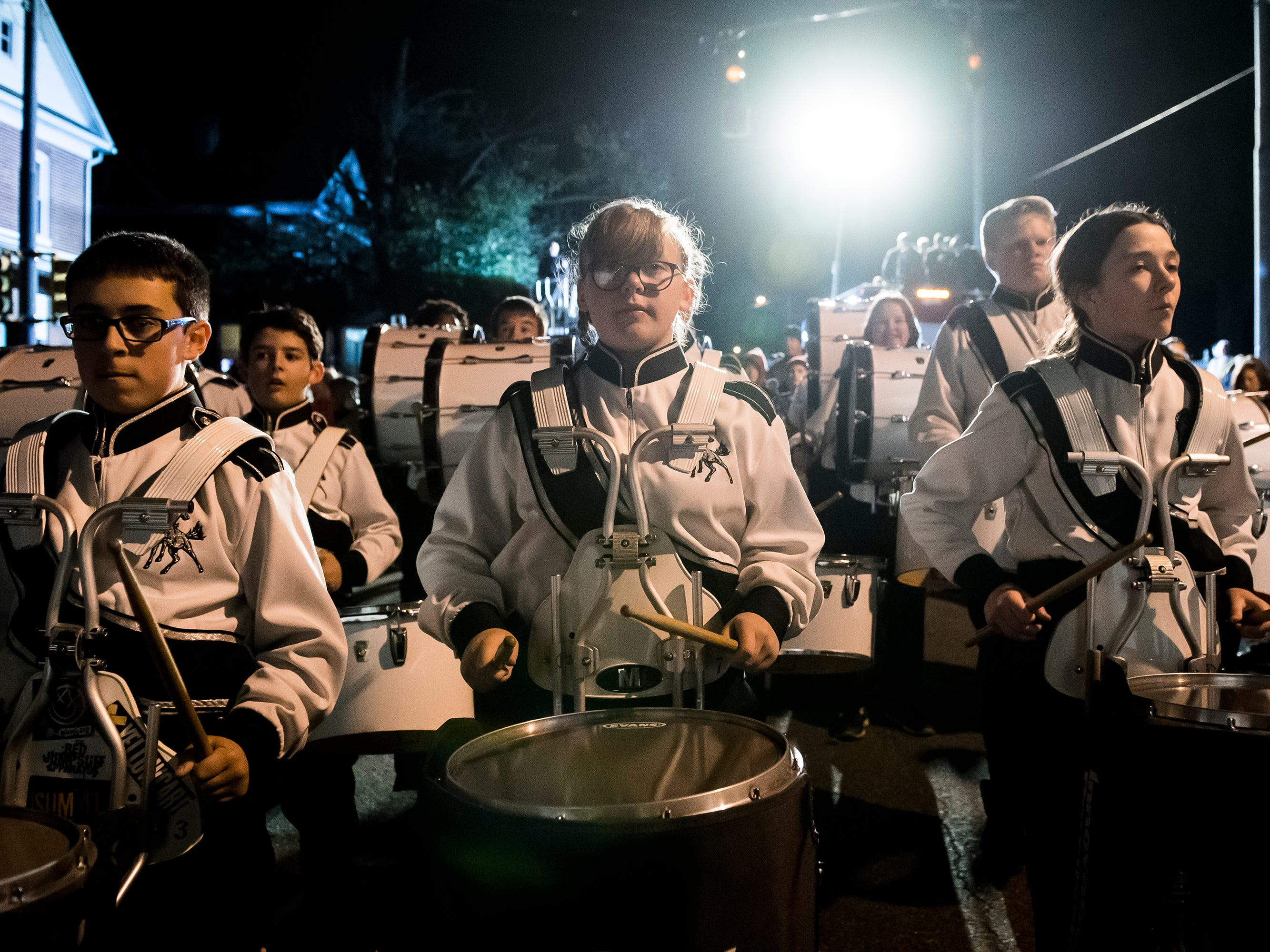 The Emory H. Markle Intermediate School marching band make their way down Baltimore Street during the 77th annual Hanover Halloween parade on Thursday, October 25, 2018.