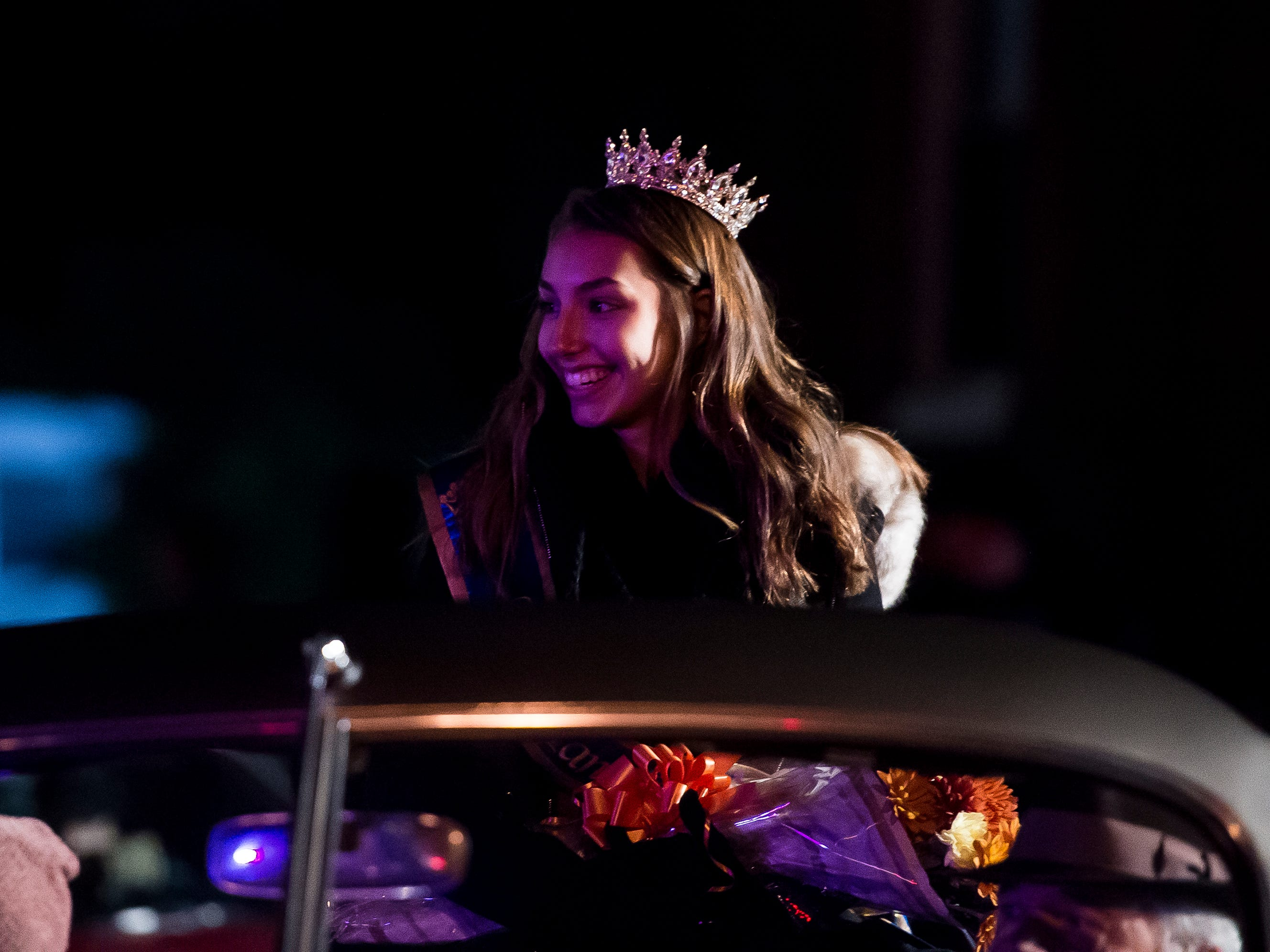 Miss Hanover Area 2018-2019, Madlyn Farley, rides in a vehicle during the 77th annual Hanover Halloween parade on Thursday, October 25, 2018.