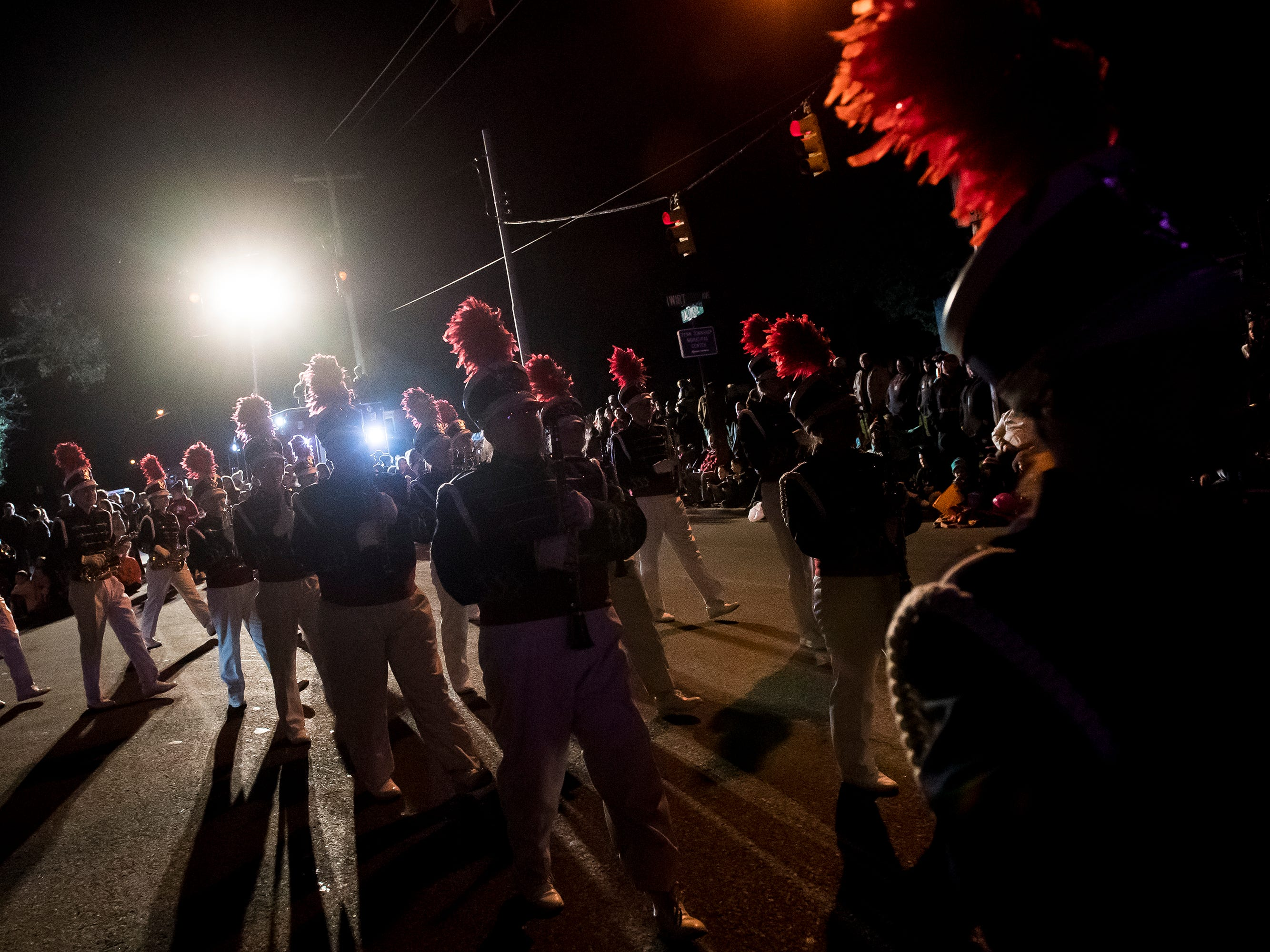 The Delone Catholic High School marching band make their way down Baltimore Street during the 77th annual Hanover Halloween parade on Thursday, October 25, 2018.