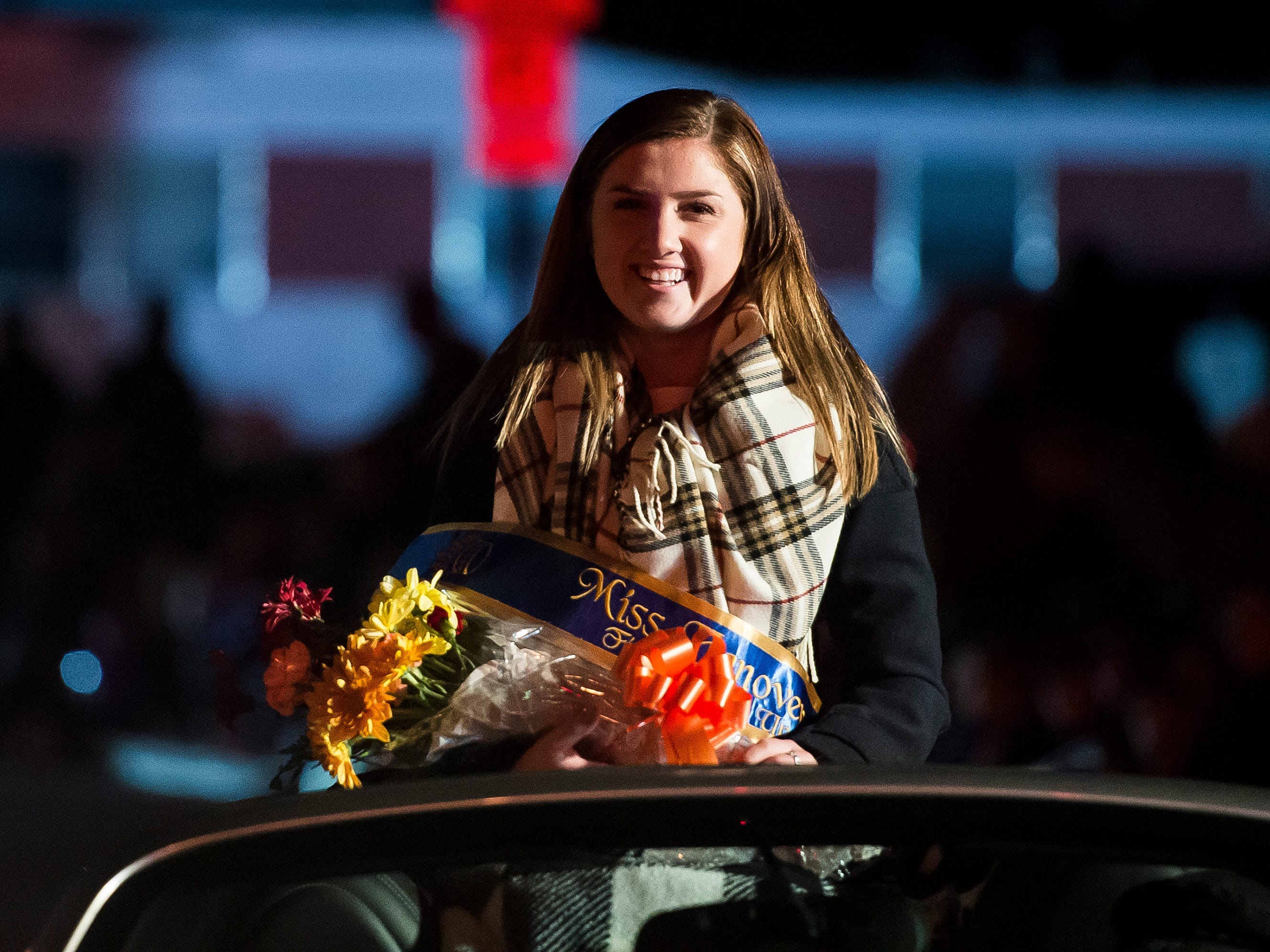 Miss Hanover Area first runner-up, Hannah Nell, rides in a vehicle during the 77th annual Hanover Halloween parade on Thursday, October 25, 2018.