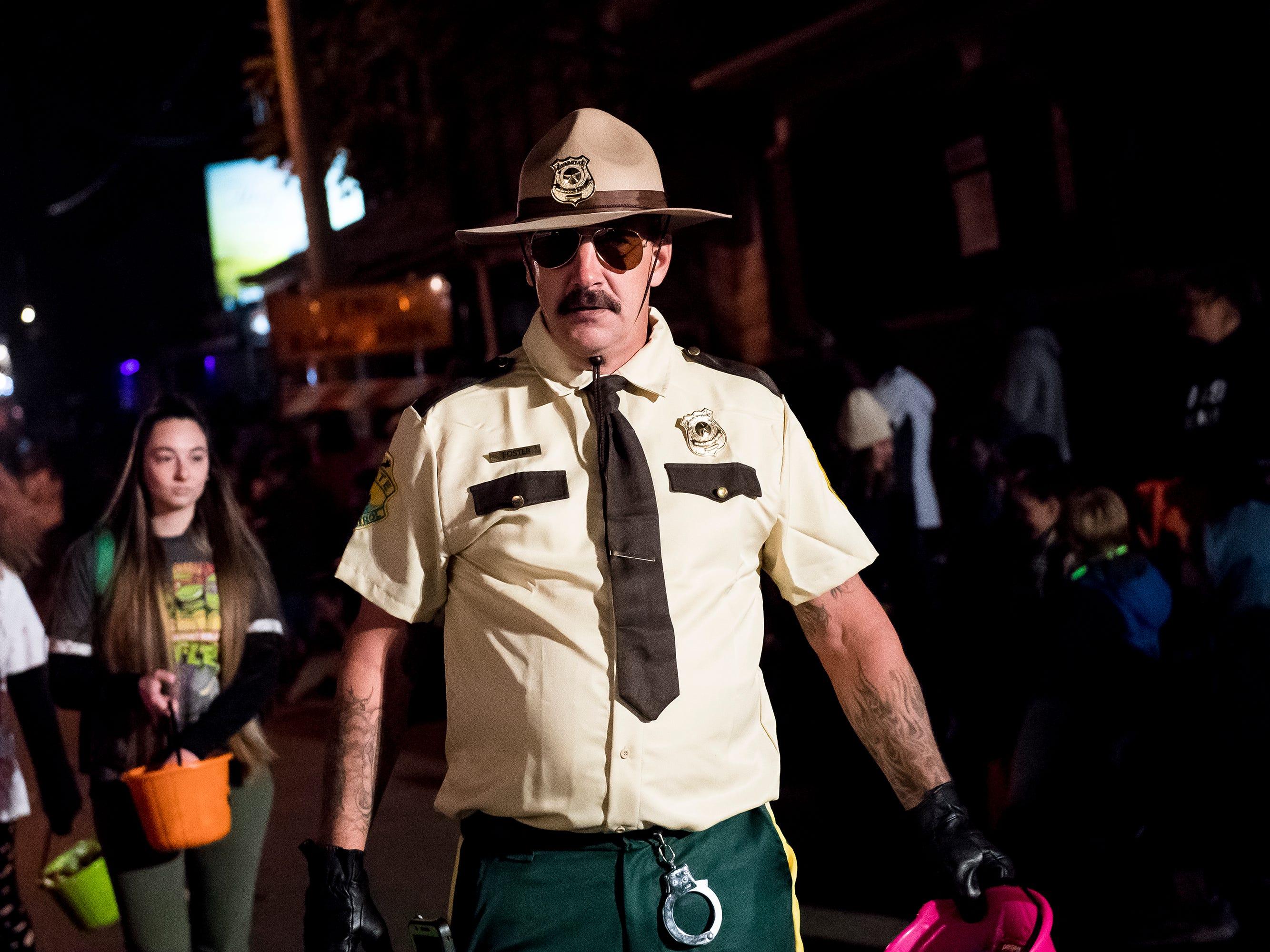 A parade participant makes their way down Baltimore Street during the 77th annual Hanover Halloween parade on Thursday, October 25, 2018.