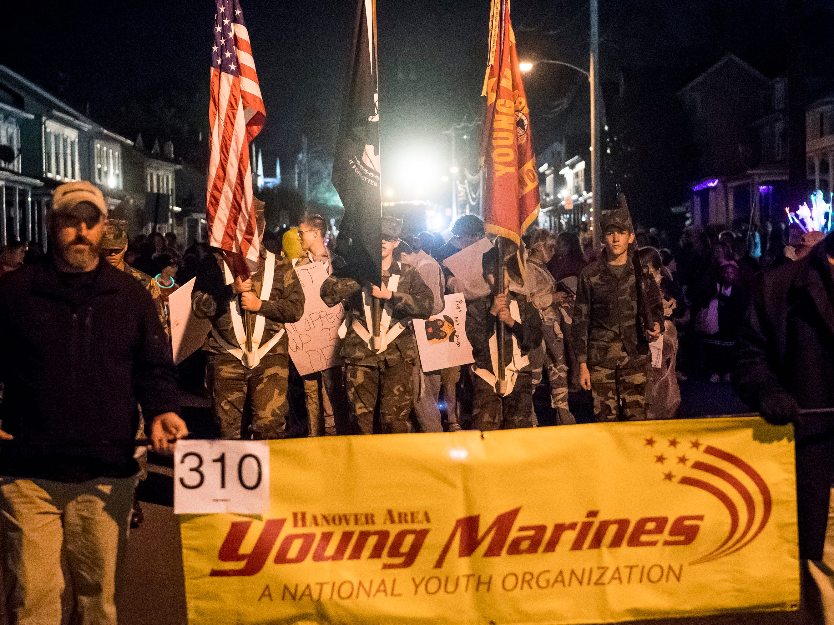 Members of the Hanover Area Young Marines march down down Baltimore Street during the 77th annual Hanover Halloween parade on Thursday, October 25, 2018.