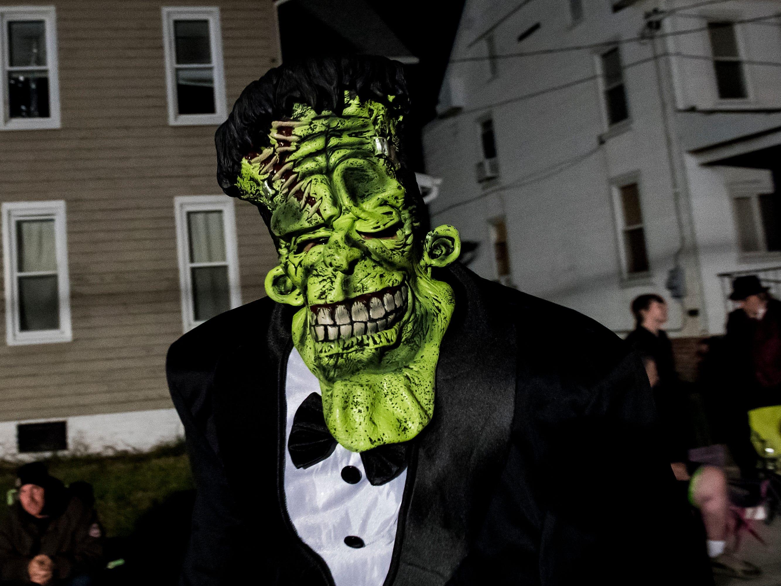 Frankenstein's monster walks down Baltimore Street during the 77th annual Hanover Halloween parade on Thursday, October 25, 2018.