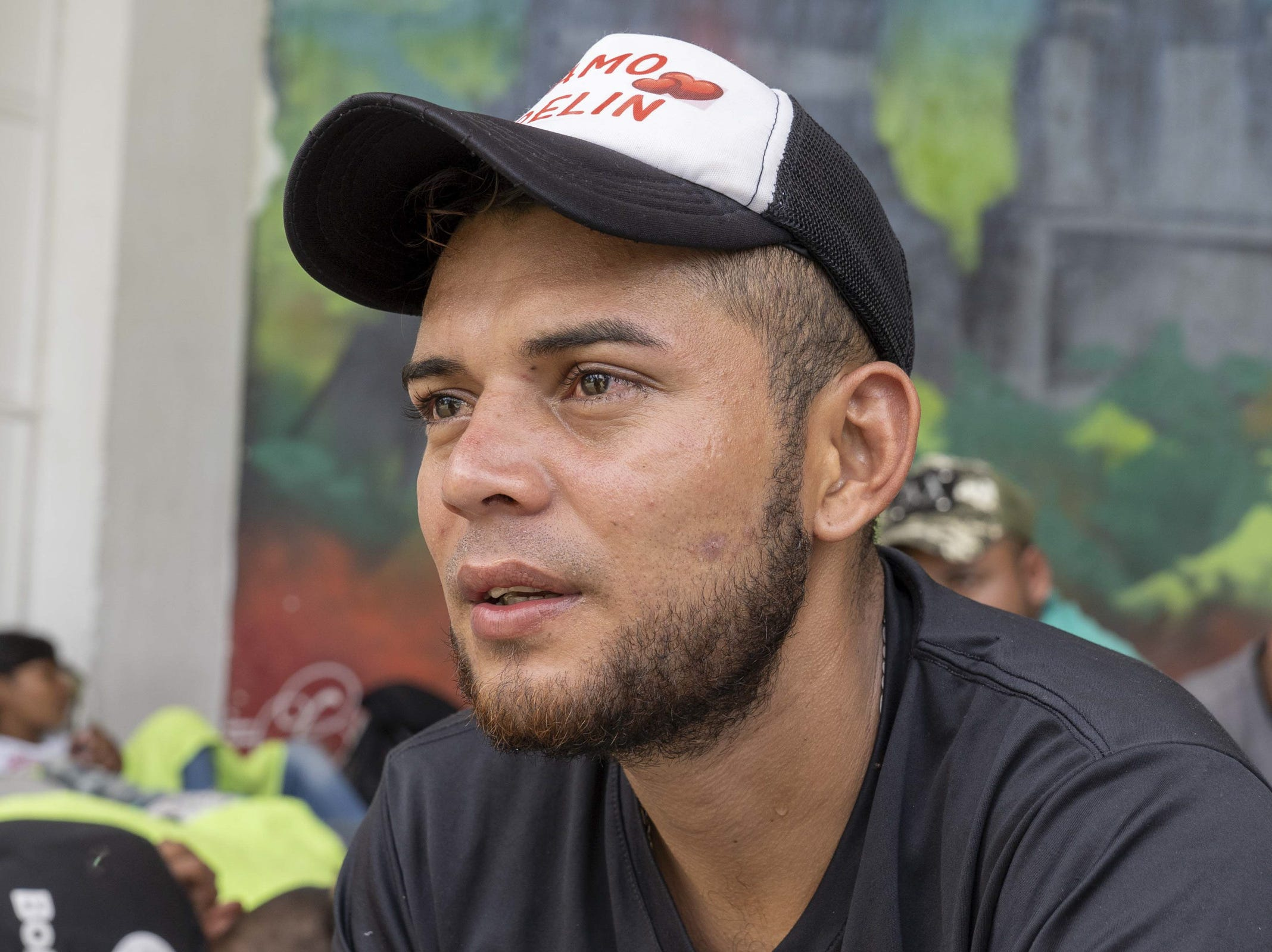 Franklin Eduardo Escobar, 26, from Honduras, rests with other migrants near a park in Tecun Uman, Guatemala.