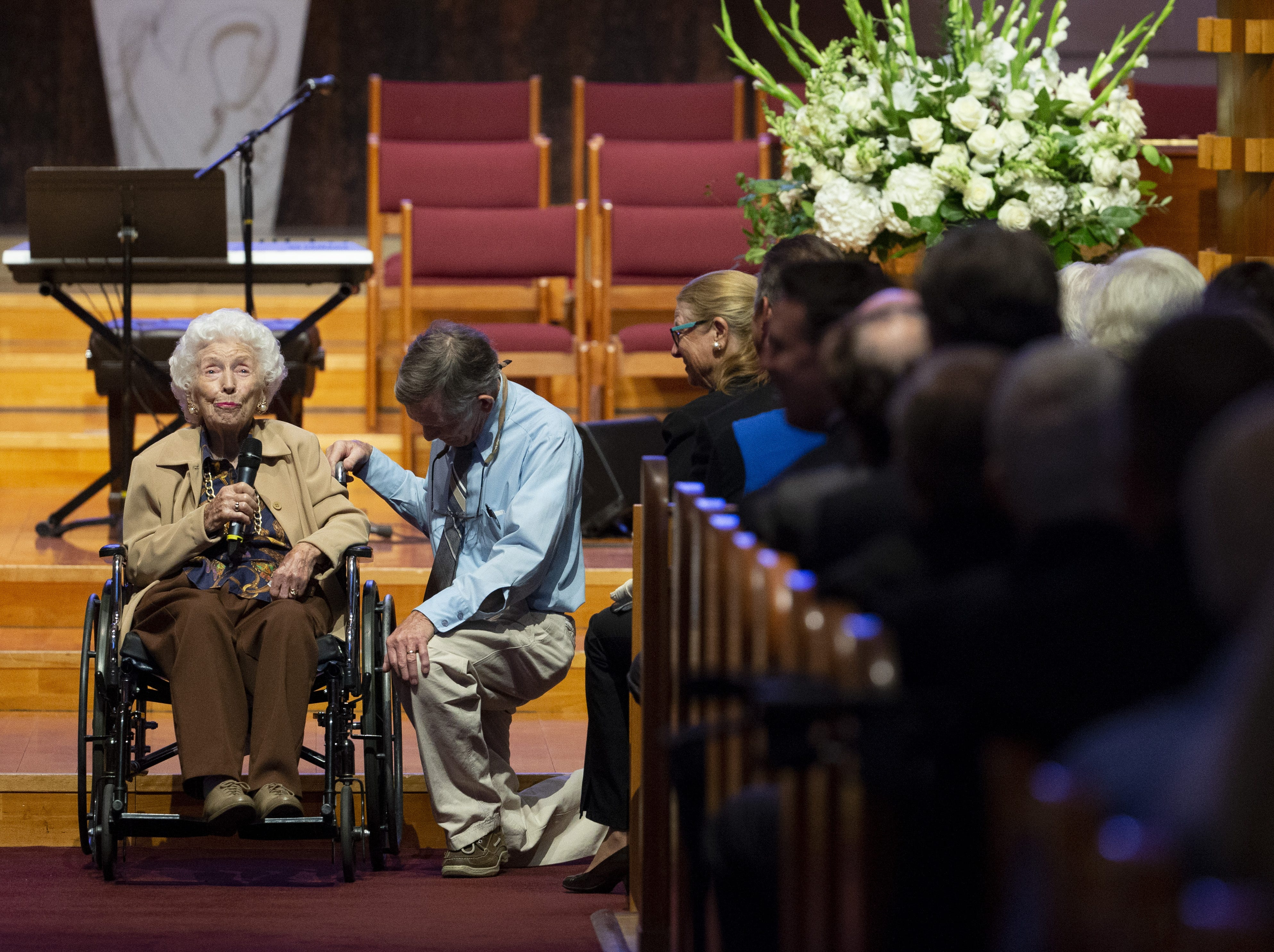 Jerry Emmett, 104, left, speaks during memorial services for her best friend, Carolyn Warner, at First United Methodist Church in on October 25, 2018, with her son, Jim at her side. Warner was the 15th Superintendent of Public Education for the state of Arizona and nearly became the state's first female governor in 1986.