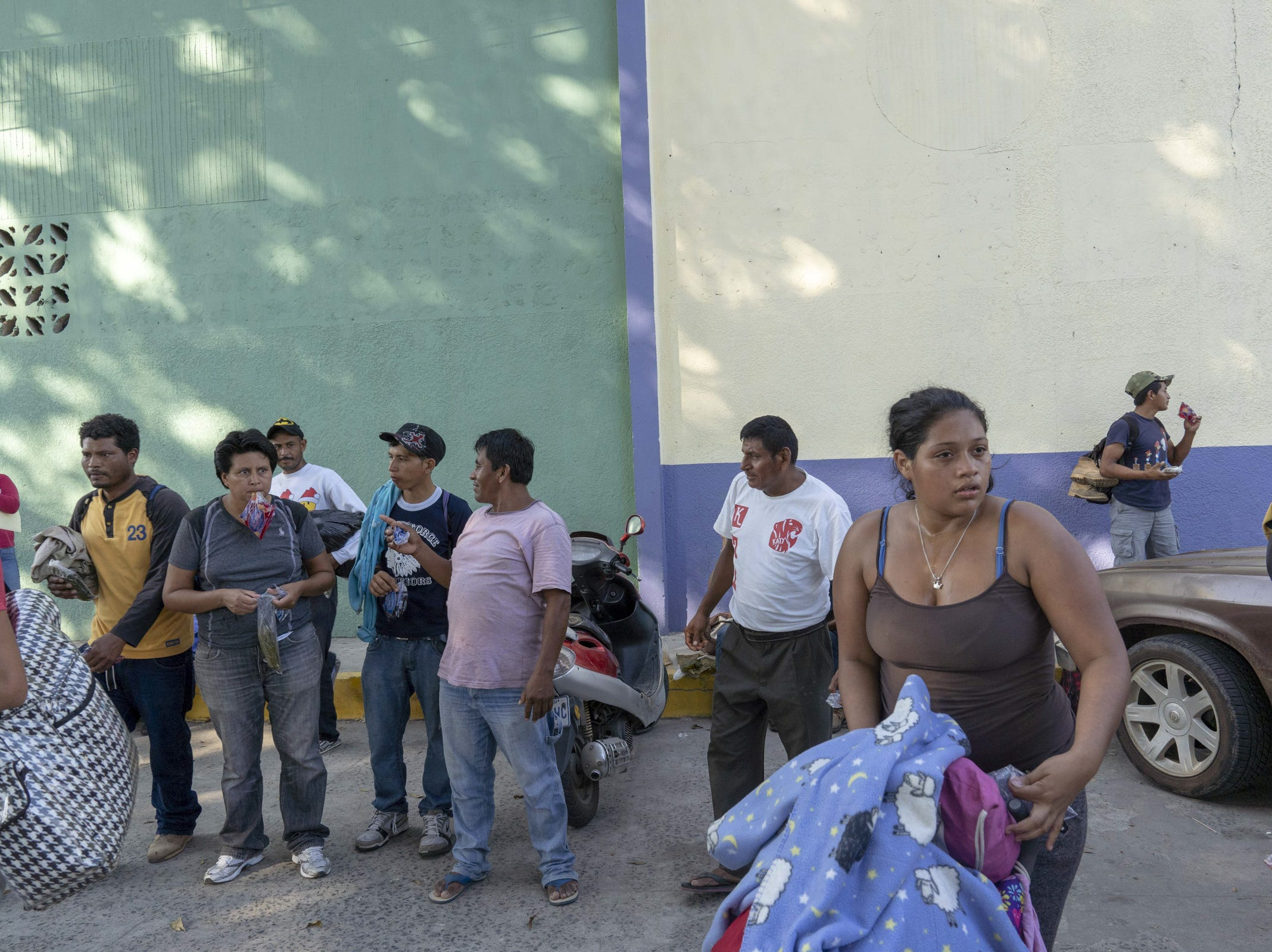 Migrants from Honduras and El Salvador gather near a park in Tecun Uman, Guatemala, on Oct. 25, 2018, as they wait to cross from Guatemala to Mexico and then head north to the United States.