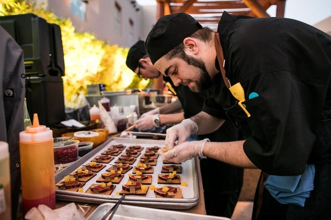 Chefs plate small plates for the Cooks + Cork festival hosted by the Scottsdale League for the Arts.
