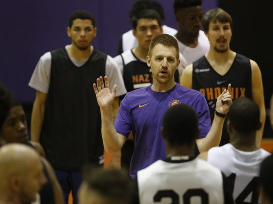 NAZ Suns head coach Bret Burchard speaks to players trying out to make the Flagstaff-based team during G-League tryouts at Talking Stick Resort Arena in Phoenix, Ariz. on Sept. 15, 2018.