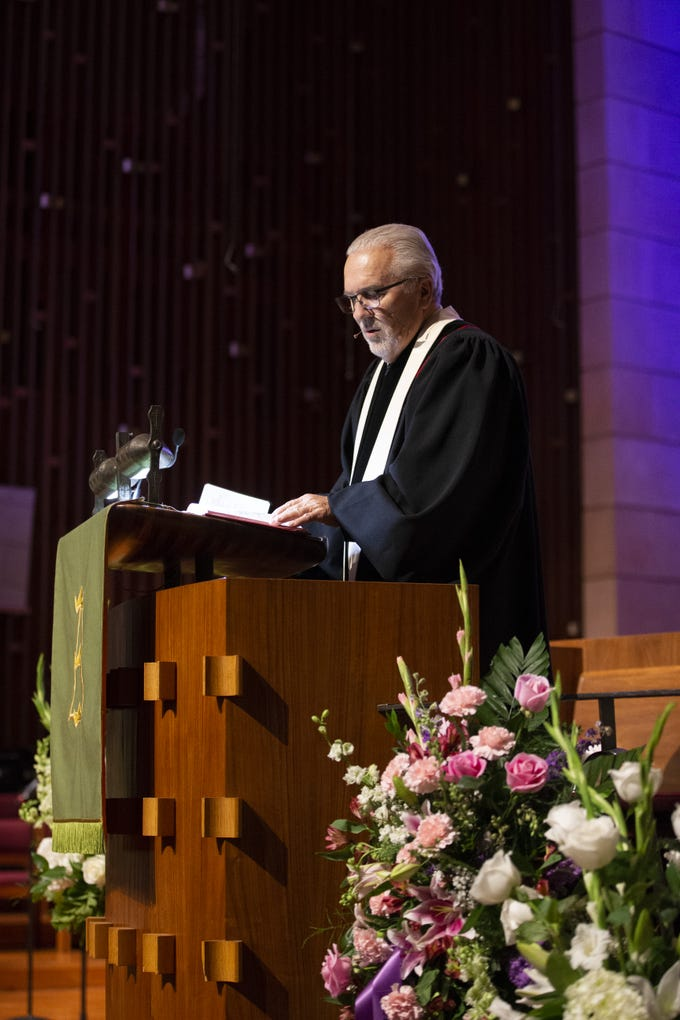 The Reverend Dr. Denny Silk speaks during memorial services at First United Methodist Church in Phoenix for Carolyn Warner on October 25, 2018. Warner was the 15th Superintendent of Public Education for the state of Arizona and nearly became the state's first female governor in 1986.