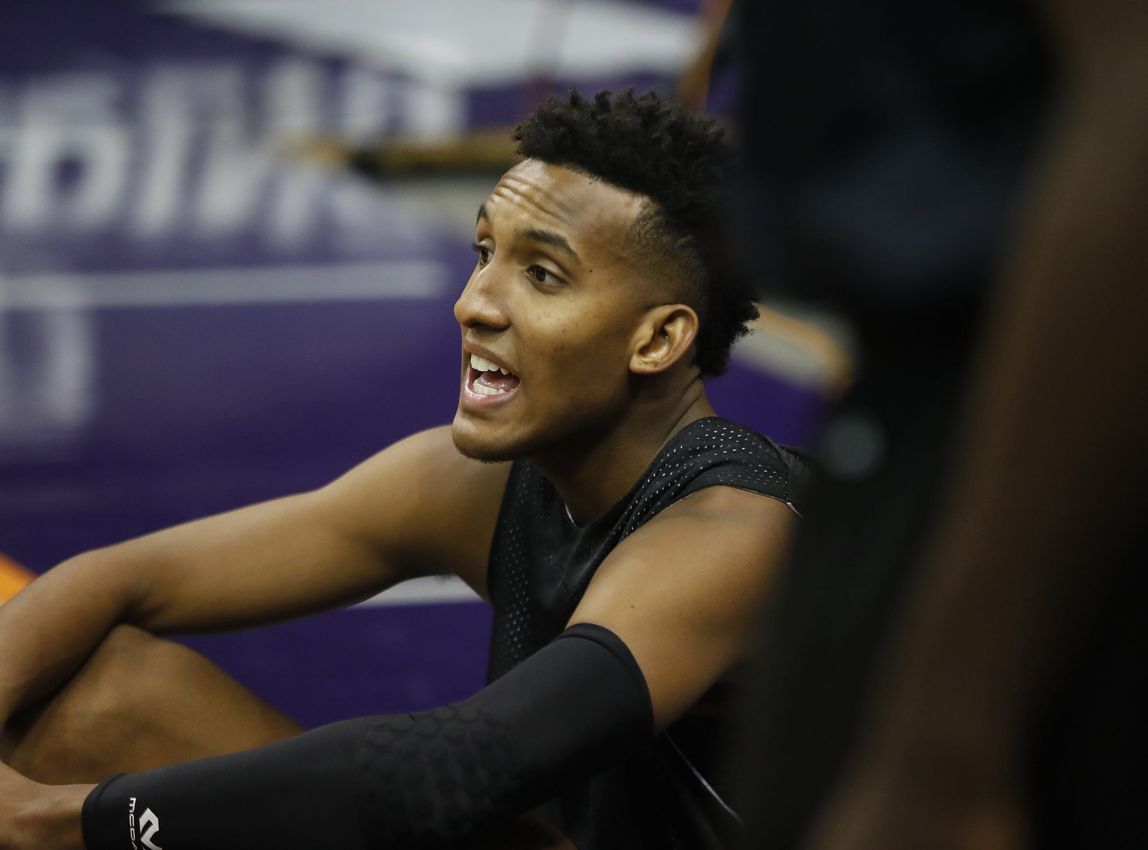 Gino Littles talks with his teammates on the bench during G-League tryouts at Talking Stick Resort Arena in Phoenix, Ariz. on Sept. 15, 2018.