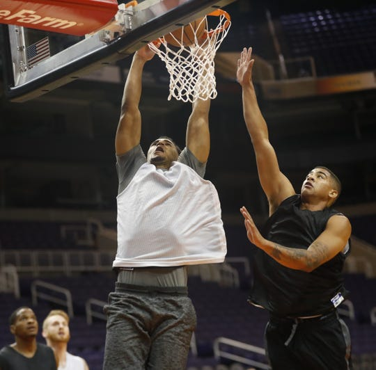 Ryan Okwudibonye dunks against a defender during G-League tryouts at Talking Stick Resort Arena in Phoenix on Sept. 15, 2018.