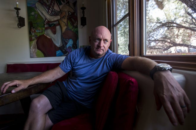 Mark Kelly, the retired astronaut and husband of former Rep. Gabby Giffords, sits for a portrait in his home in Tucson on Monday, Aug. 6, 2018.