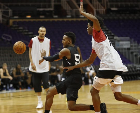 Gino Littles passes against other tryout attendees during G-League tryouts at Talking Stick Resort Arena in Phoenix on Sept. 15, 2018.