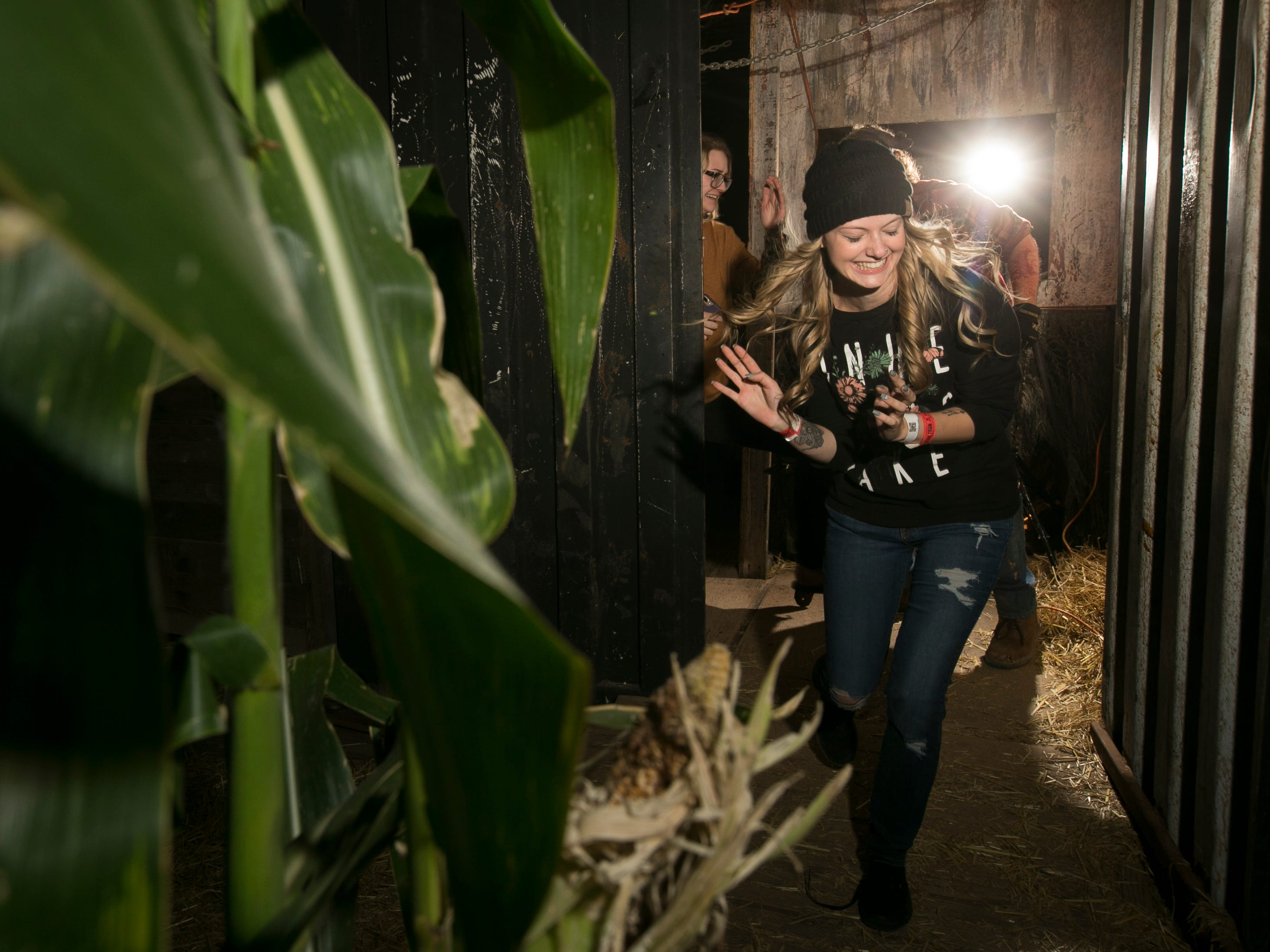 People react to the frights at Fear Farm in Phoenix, Ariz. on Oct. 25, 2018.