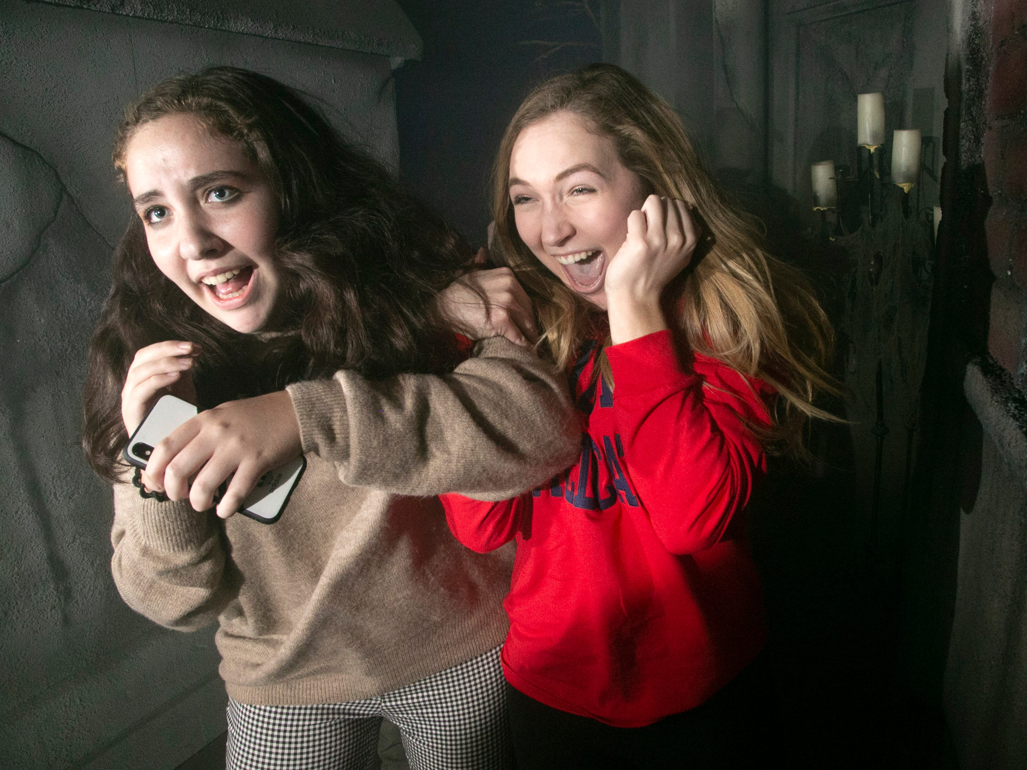 People react to frights, scares and startles at the 13th Floor Haunted House in Phoenix on Thursday, October 25, 2018.