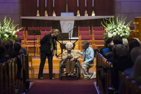 Jerry Emmett, 104, center,  speaks during memorial services for her best friend, Carolyn Warner, at First United Methodist Church in on October 25, 2018. Warner was the 15th Superintendent of Public Education for the state of Arizona and nearly became the state's first female governor in 1986. Caron Lieber, daughter of Carolyn Warren is left and Emmett's son, Jim, is right.