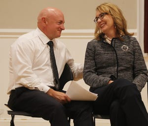Mark Kelly and his wife, former Rep. Gabby Giffords, wait to speak to supporters of New Jersey congressional candidate  Mikie Sherrill.