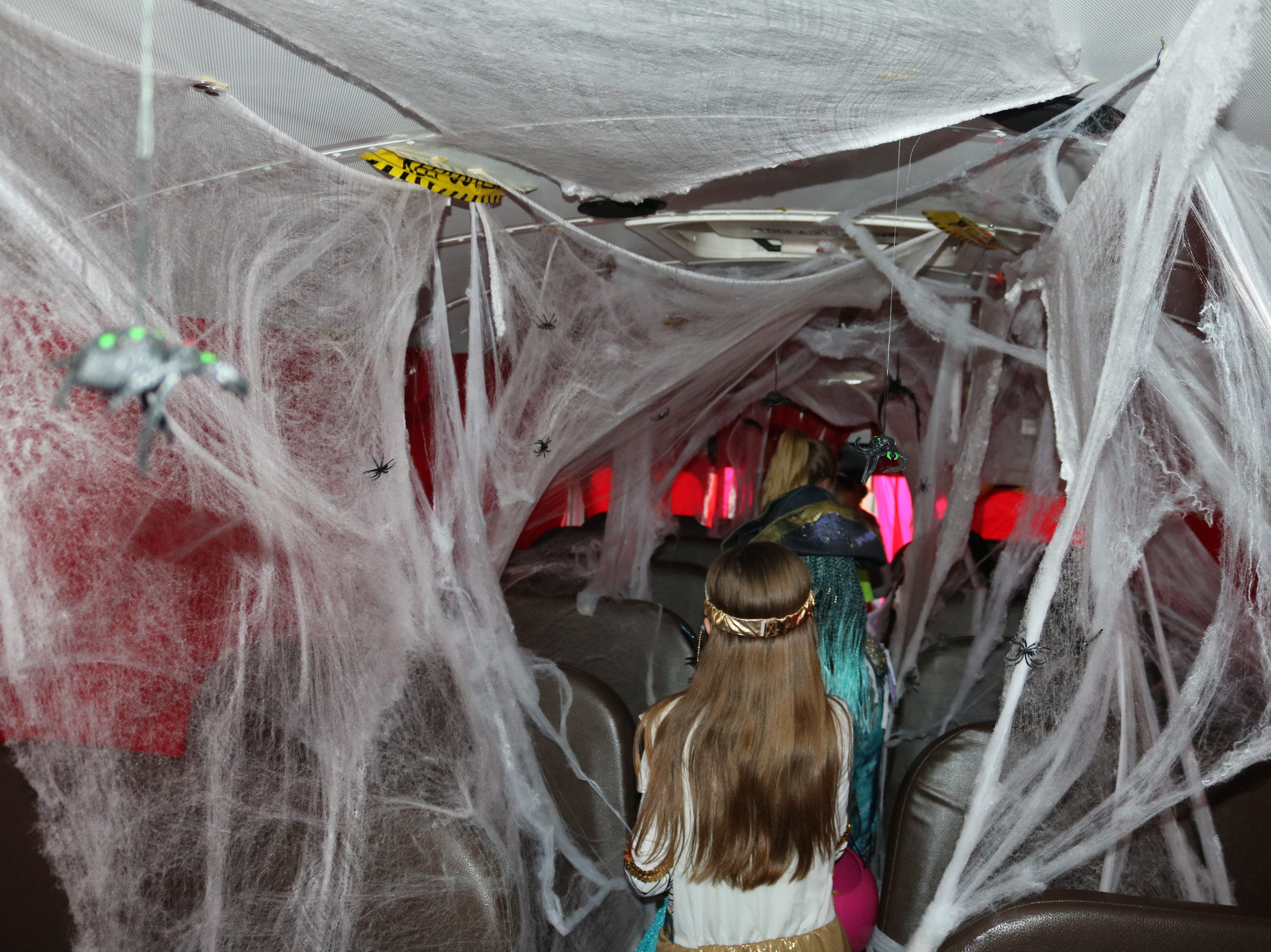 "Oak Harbor High School's ""Halloween in the Halls"" event included a spooky walk through a haunted school bus on Thursday."