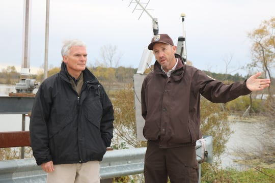 U.S. Rep. Bob Latta, R-Bowling Green, left, toured the grounds of the Ottawa National Wildlife Refuge with its director, Jason Lewis, right, on Friday.