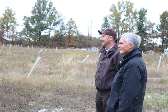 Jason Lewis, director of the Ottawa National Wildlife Refuge, and U.S. Rep. Bob Latta, R-Bowling Green, walk through a new restoration project planned to be open public hunting grounds in Ottawa County.