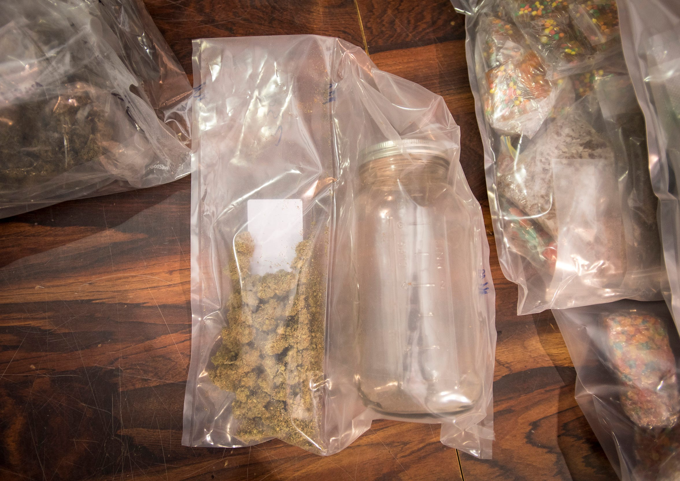 Marijuana and a storage container are seen in an evidence bag at the St. Clair County Sheriff's Drug Task Force.