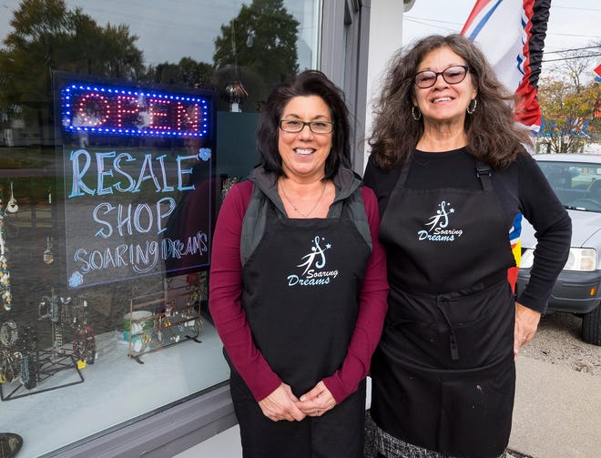Laura MacDonald, left, and Julie McCoy opened Soaring Dreams in East China Township, a volunteer-run resale store for their developmentally disabled children to work at.