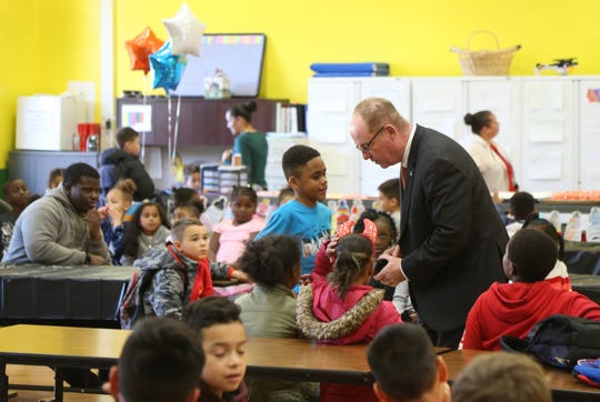 City of Poughkeepsie Mayor Rob Rolison speaks to third grader Jordan Smack during the Family Services' Lights on Afterschool rally  at Krieger Elementary School in the City of Poughkeepsie on October 25, 2018.