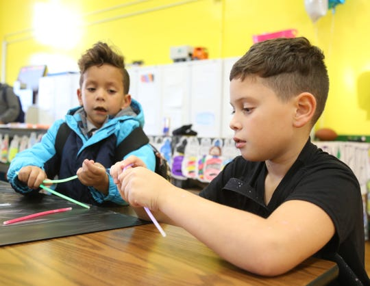 From left, Jovanny and Aiden Mesa work on an arts and crafts project during the Family Services' Lights on Afterschool rally  at Krieger Elementary School in the City of Poughkeepsie on October 25, 2018.