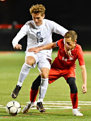 West York's Aidan Clark, left, and Susquehannock's Dalton Pearson battle for control of the ball during boys' District 3, Class 3-A soccer quarterfinal game action at Susquehannock High School in Glen Rock, Thursday, Oct. 25, 2018. West York would win the game 1-0. Dawn J. Sagert photo