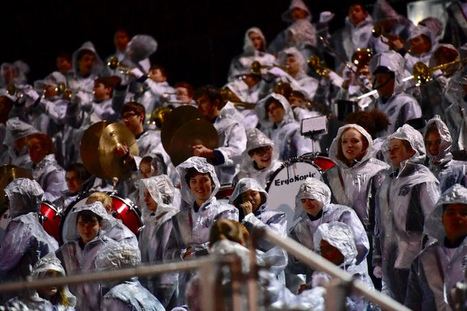 The Chambersburg band dons the rain gear ahead of Friday's game against Carlisle.