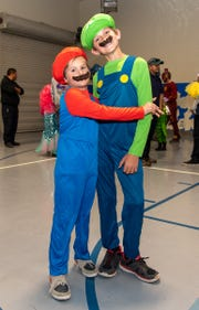 Mason Fisher, 7, left, and his brother Hayden, 11, dressed as the Mario Brothers.
