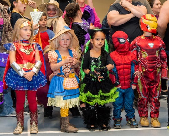 Kids in the 3 to 5 year-old category wait for the costume contest judging.