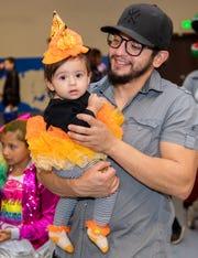Ximena Jimenez, 10 months, is held by dad, Moses Jimenez.