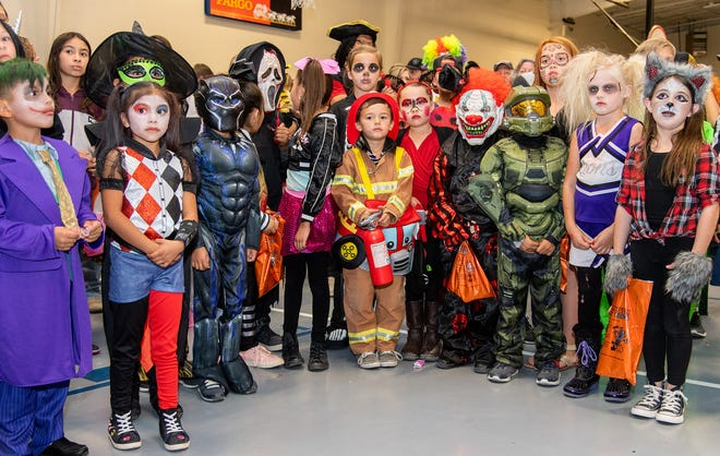 Kids in the 6 to 9 year-old category wait for the costume contest judges to decide the winner.