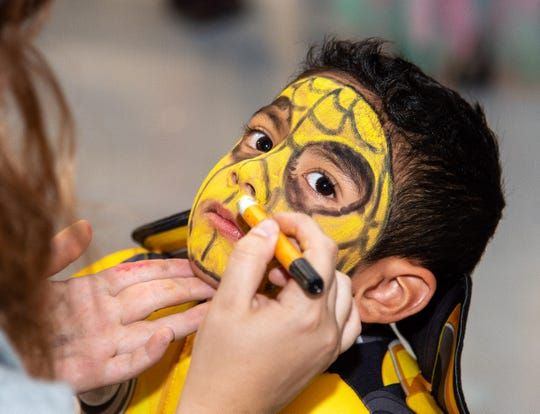 Damian Fuentes, 4, has his face painted.