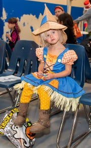 Madilynn Dion, 3, came to the party dressed as a scarecrow.