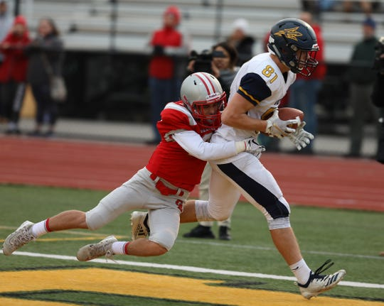 Victor's Jacob Cole-Allen gets in the endzone for a touchdown taking Canandaigua's Colin Greene with him during their semifinal game at The College of Brockport.