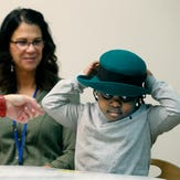 Najir Jones, 4, tries on a hat during a program at the Mary Cariola Children's Center for occupational and physical therapy and speech therapy, among other things.