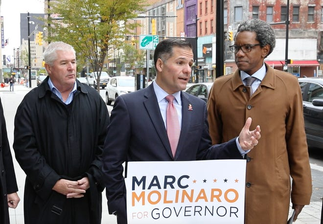 Marc Molinaro, Republican gubernatorial candidate, center, is joined by Republican Attorney General candidate Keith Wofford, right, and state Assembly Minority Leader Brian Kolb, left, in calling for another debate with Gov. Andrew Cuomo dealing with upstate issues, during a press conference Friday in downtown Rochester.