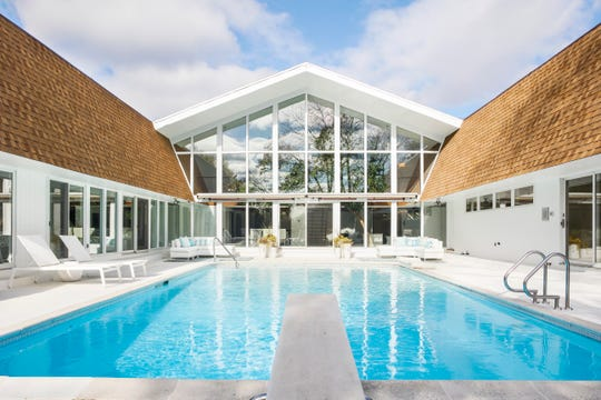 The pool is nestled in the U-shaped design of the home.