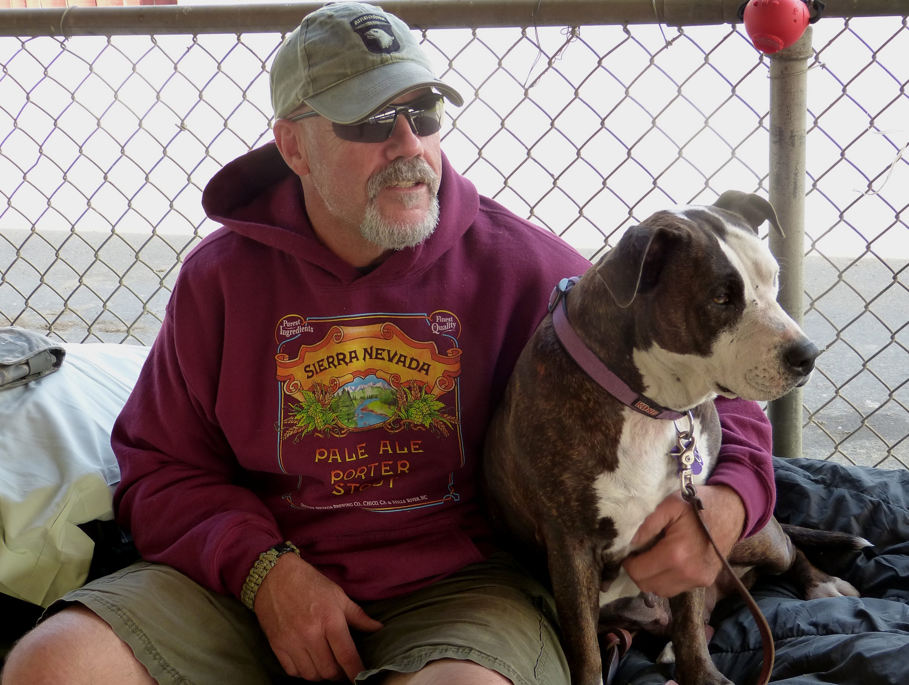 U.S. Army veteran Steve Cornett spends a little quality time with his dog, Hannah, at the North Valley Stand Down.