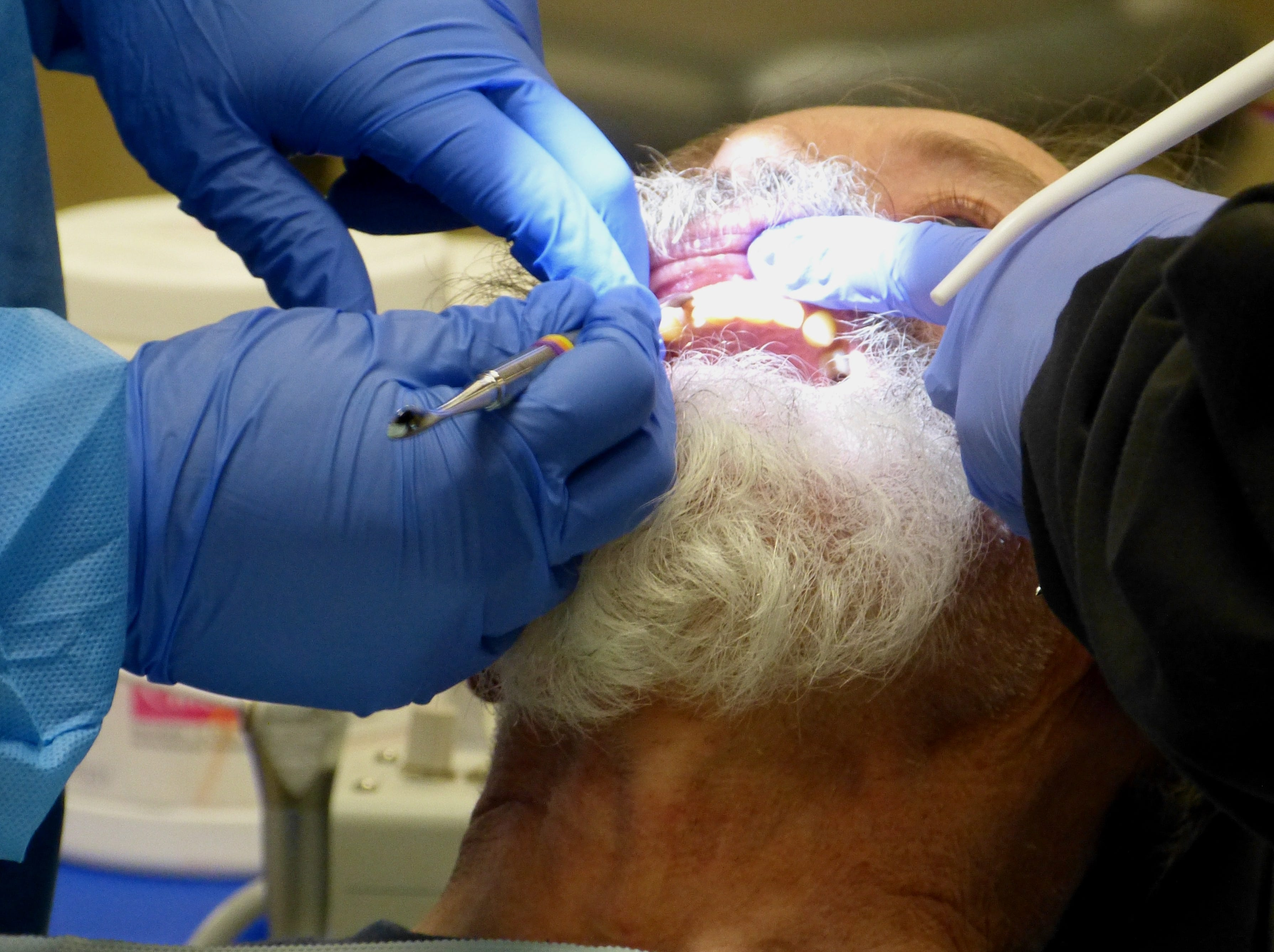 Cliff Emerson, a 69-year-old U.S. Marine Corps veteran, got a tooth pulled at the North Valley Stand Down.